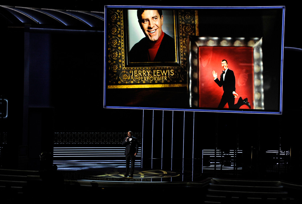 . Christopher Jackson sings as a picture of Jerry Lewis appears onscreen during an in memoriam tribute at the 69th Primetime Emmy Awards on Sunday, Sept. 17, 2017, at the Microsoft Theater in Los Angeles. (Photo by Chris Pizzello/Invision/AP)