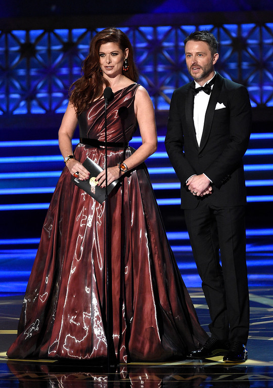 . Debra Messing, left, and Chris Hardwick present the award for outstanding lead actress in a comedy series at the 69th Primetime Emmy Awards on Sunday, Sept. 17, 2017, at the Microsoft Theater in Los Angeles. (Photo by Chris Pizzello/Invision/AP)