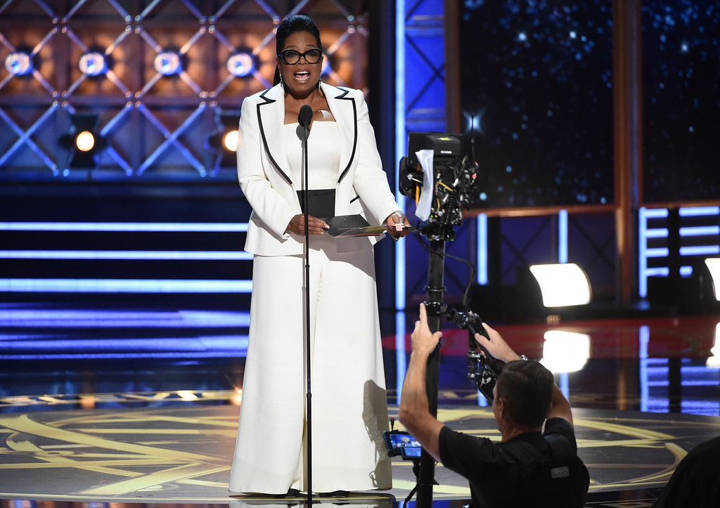 . Oprah Winfrey presents the award for outstanding drama series at the 69th Primetime Emmy Awards on Sunday, Sept. 17, 2017, at the Microsoft Theater in Los Angeles. (Photo by Phil McCarten/Invision for the Television Academy/AP Images)