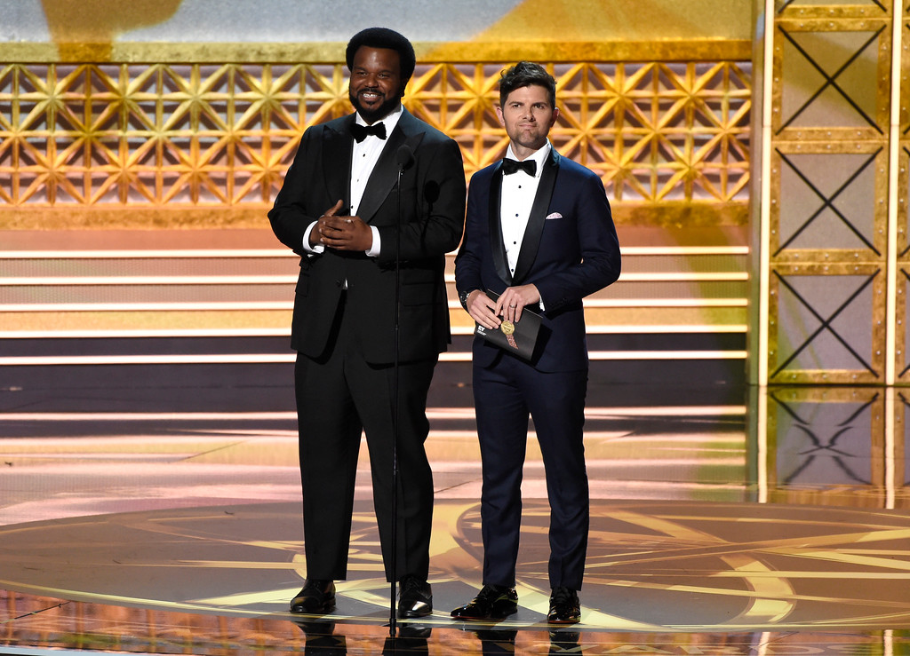 . Craig Robinson, left, and Adam Scott present the award for outstanding directing for a variety series at the 69th Primetime Emmy Awards on Sunday, Sept. 17, 2017, at the Microsoft Theater in Los Angeles. (Photo by Chris Pizzello/Invision/AP)