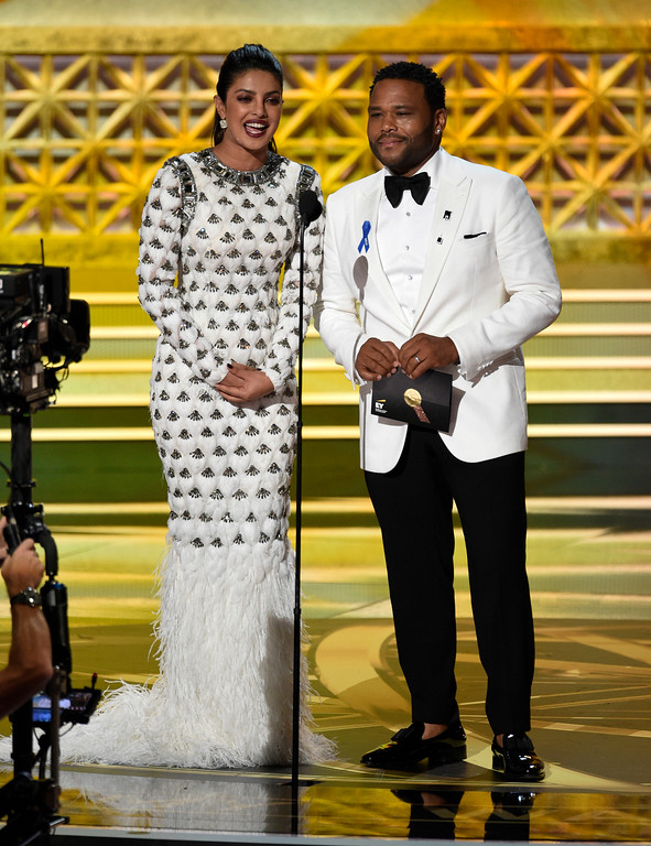 . Priyanka Chopra, left, and Anthony Anderson present the award for outstanding variety talk series at the 69th Primetime Emmy Awards on Sunday, Sept. 17, 2017, at the Microsoft Theater in Los Angeles. (Photo by Chris Pizzello/Invision/AP)