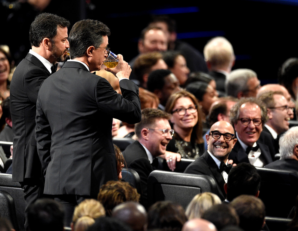 . Jimmy Kimmel, left, and host Stephen Colbert drink in the audience at the 69th Primetime Emmy Awards on Sunday, Sept. 17, 2017, at the Microsoft Theater in Los Angeles. (Photo by Chris Pizzello/Invision/AP)