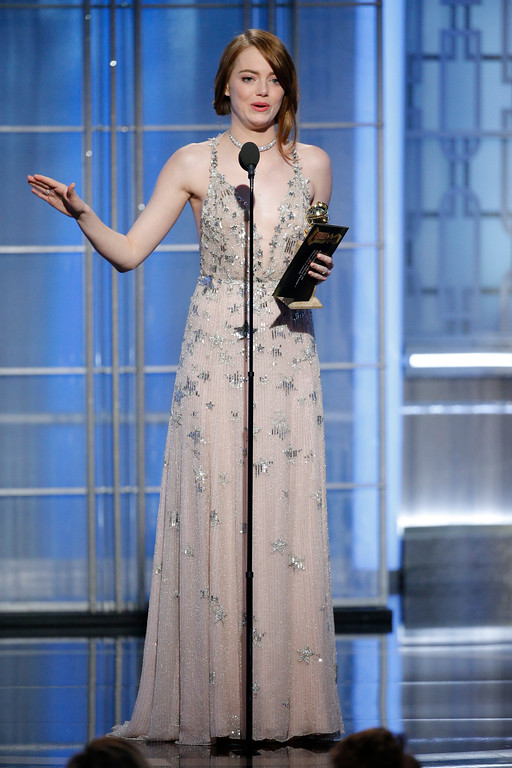 ". This image released by NBC shows Emma Stone with the award for best actress in a motion picture comedy or musical for her role in ""La La Land\"" at the 74th Annual Golden Globe Awards at the Beverly Hilton Hotel in Beverly Hills, Calif., on Sunday, Jan. 8, 2017. (Paul Drinkwater/NBC via AP)"