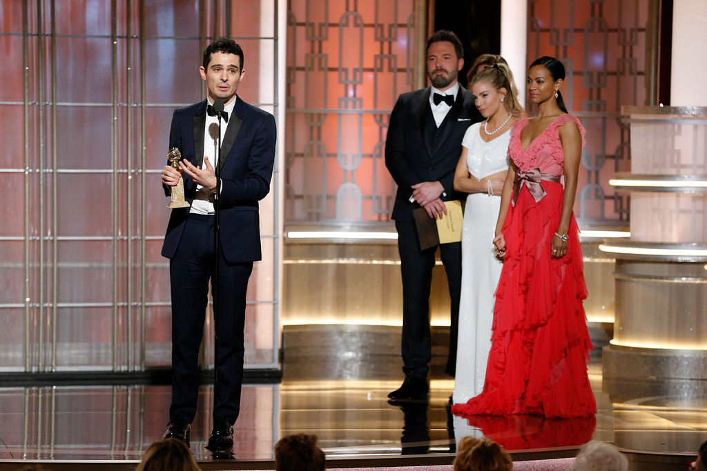 ". This image released by NBC shows Damien Chazelle, winner of the best director for ""La La Land,\"" at the 74th Annual Golden Globe Awards at the Beverly Hilton Hotel in Beverly Hills, Calif., on Sunday, Jan. 8, 2017. (Paul Drinkwater/NBC via AP)"