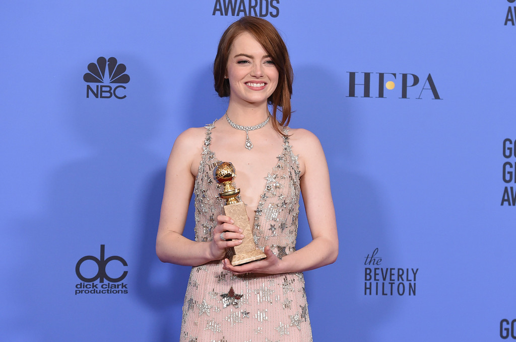 ". Emma Stone poses in the press room with the award for best performance by an actress in a motion picture - musical or comedy for ""La La Land\"" at the 74th annual Golden Globe Awards at the Beverly Hilton Hotel on Sunday, Jan. 8, 2017, in Beverly Hills, Calif. (Photo by Jordan Strauss/Invision/AP)"