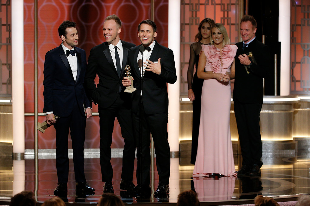 ". This image released by NBC shows Justin Hurwitz, from left, Justin Paul and Benj Pasek, winners of the best original song for ""La La Land,\"" at the 74th Annual Golden Globe Awards at the Beverly Hilton Hotel in Beverly Hills, Calif., on Sunday, Jan. 8, 2017. (Paul Drinkwater/NBC via AP)"