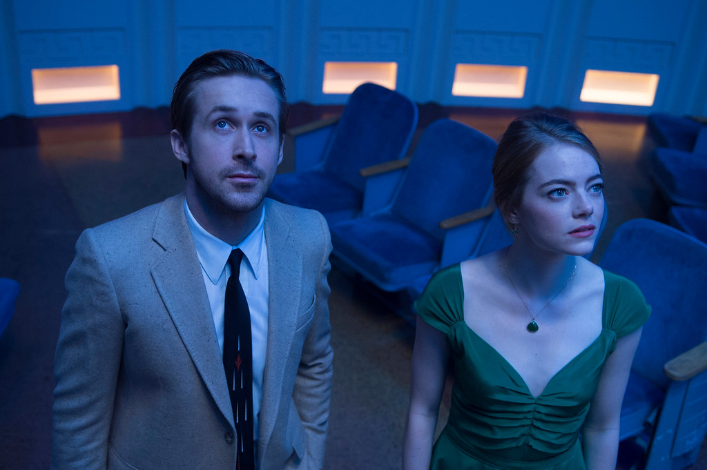 ". This image released by Lionsgate shows Ryan Gosling, left, and Emma Stone in a scene from, ""La La Land.\"" The film danced its way into the winner�s circle at the 74th Golden Globe Awards on Sunday, January 8, 2017, taking all seven trophies it was nominated for. (Dale Robinette/Lionsgate via AP)"