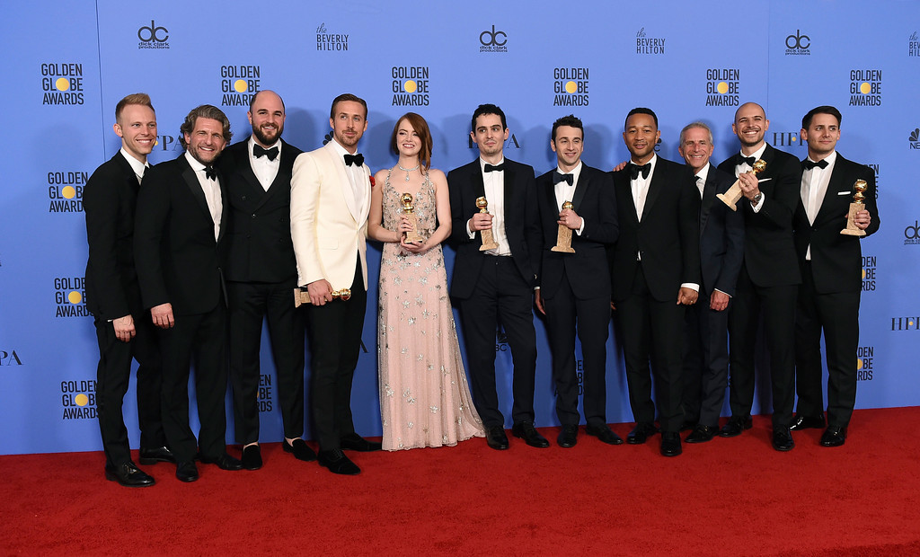 ". The cast and crew of ""La La Land\"" poses in the press room with the award for best motion picture - musical or comedy at the 74th annual Golden Globe Awards at the Beverly Hilton Hotel on Sunday, Jan. 8, 2017, in Beverly Hills, Calif. (Photo by Jordan Strauss/Invision/AP)"