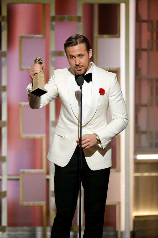 ". This image released by NBC shows Ryan Gosling with the award for best actor in a motion picture musical or comedy for ""La La Land,\"" at the 74th Annual Golden Globe Awards at the Beverly Hilton Hotel in Beverly Hills, Calif., on Sunday, Jan. 8, 2017. (Paul Drinkwater/NBC via AP)"