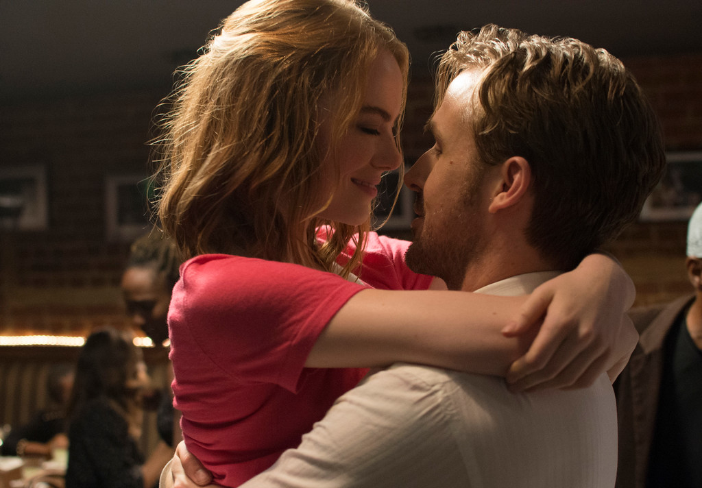 ". This image released by Lionsgate shows Ryan Gosling, right, and Emma Stone in a scene from, ""La La Land.\"" The film danced its way into the winner�s circle at the 74th Golden Globe Awards on Sunday, January 8, 2017, taking all seven trophies it was nominated for. (Dale Robinette/Lionsgate via AP)"
