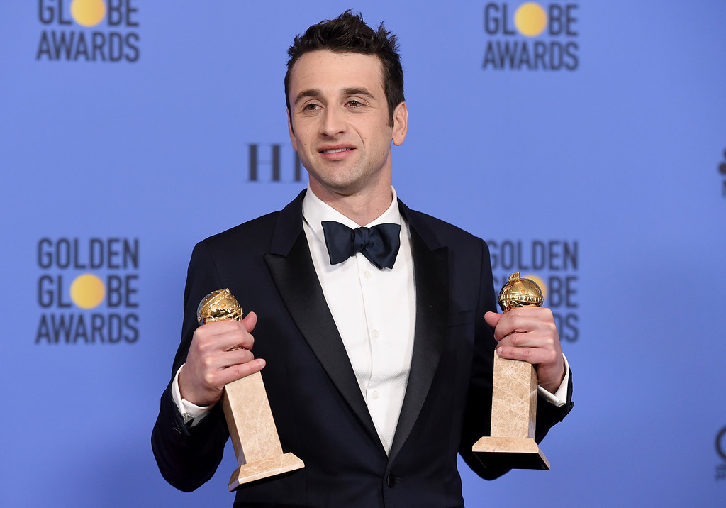 ". Justin Hurwitz poses in the press room with the award for best original song for motion picture for ""City Of Stars\"" and best original score - motion picture for \""La La Land\"" at the 74th annual Golden Globe Awards at the Beverly Hilton Hotel on Sunday, Jan. 8, 2017, in Beverly Hills, Calif. (Photo by Jordan Strauss/Invision/AP)"