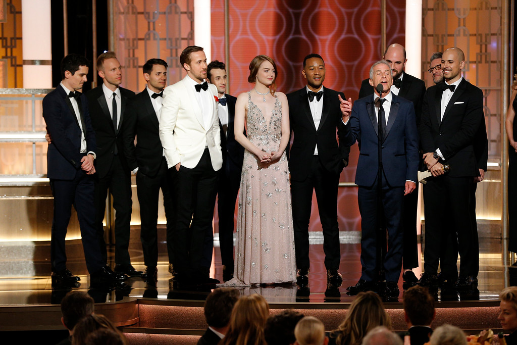 ". This image released by NBC shows the cast and crew of ""La La Land\"" winner of the award for best motion picture musical or comedy at the 74th Annual Golden Globe Awards at the Beverly Hilton Hotel in Beverly Hills, Calif., on Sunday, Jan. 8, 2017. (Paul Drinkwater/NBC via AP)"