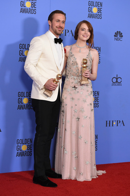 ". Ryan Gosling, left, and Emma Stone pose in the press room with the award for best performance by an actor and actress in a motion picture - musical or comedy for ""La La Land\"" at the 74th annual Golden Globe Awards at the Beverly Hilton Hotel on Sunday, Jan. 8, 2017, in Beverly Hills, Calif. (Photo by Jordan Strauss/Invision/AP)"