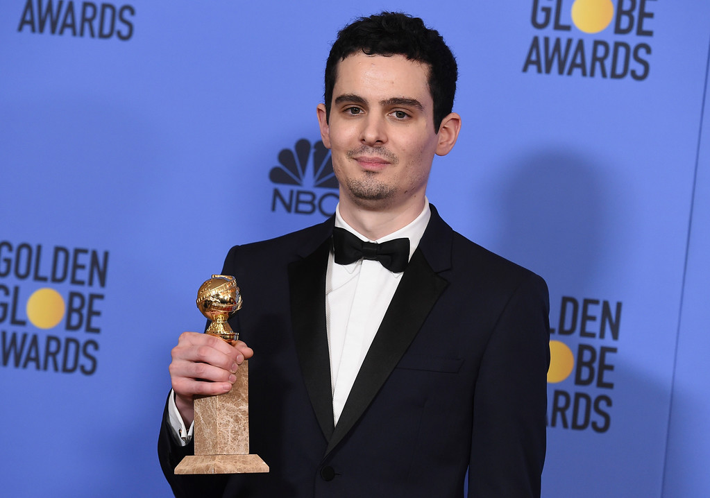 ". Damien Chazelle poses in the press room with the award for best screenplay - motion picture for ""La La Land\"" at the 74th annual Golden Globe Awards at the Beverly Hilton Hotel on Sunday, Jan. 8, 2017, in Beverly Hills, Calif. (Photo by Jordan Strauss/Invision/AP)"