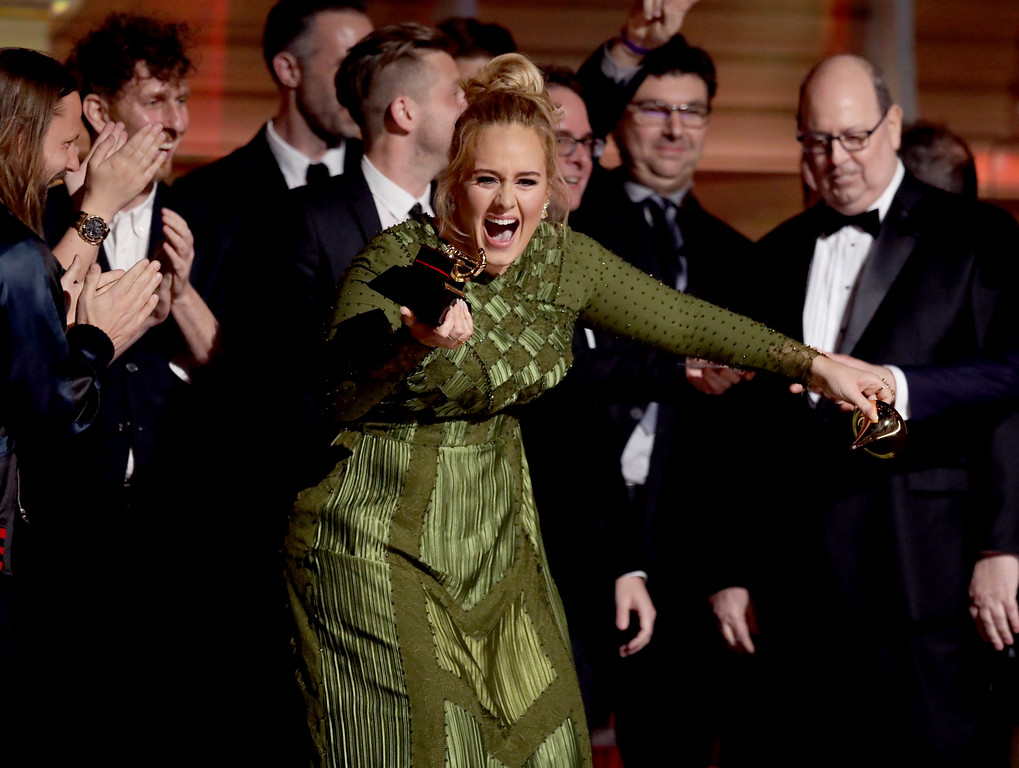 ". Adele accepts the award for album of the year for ""25\"" at the 59th annual Grammy Awards on Sunday, Feb. 12, 2017, in Los Angeles. (Photo by Matt Sayles/Invision/AP)"