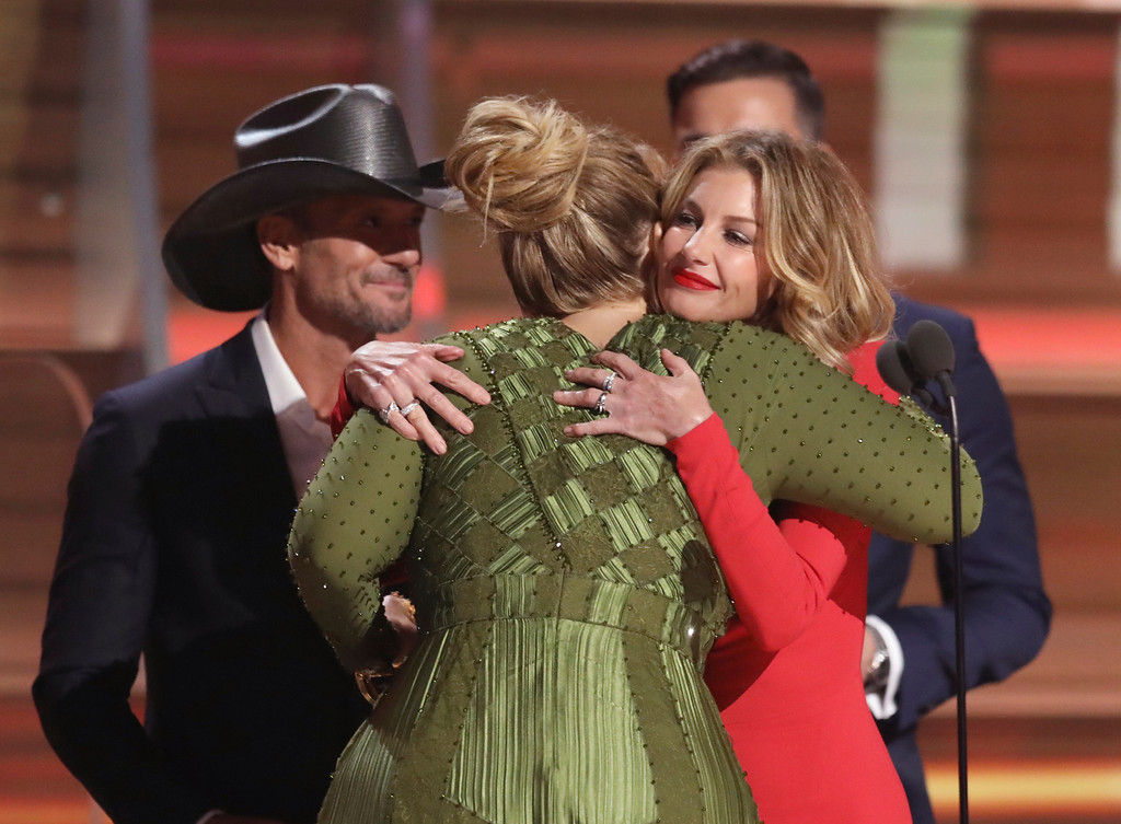 ". Tim McGraw, left, and Faith Hill, right, congratulate Adele after presenting her with the award for record of the year for ""Hello\"" at the 59th annual Grammy Awards on Sunday, Feb. 12, 2017, in Los Angeles. (Photo by Matt Sayles/Invision/AP)"
