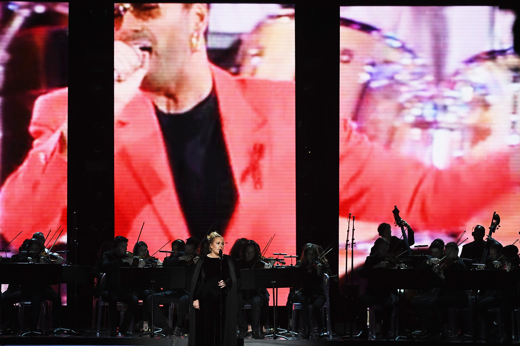 . LOS ANGELES, CA - FEBRUARY 12:  An image of the late George Michael is projected on a video screen while recording artist Adele performs onstage during The 59th GRAMMY Awards at STAPLES Center on February 12, 2017 in Los Angeles, California.  (Photo by Kevin Winter/Getty Images for NARAS)