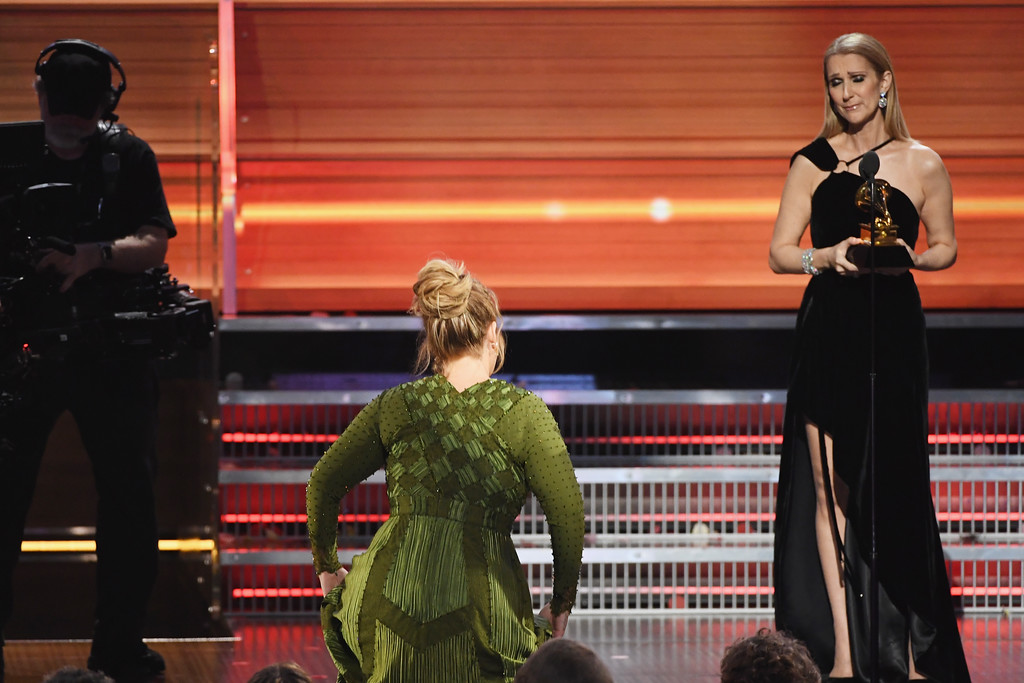 . LOS ANGELES, CA - FEBRUARY 12:  Recording artist Celine Dion (R) presents the Song Of The Year award for \'Hello\' to songwriter Adele Adkins onstage during The 59th GRAMMY Awards at STAPLES Center on February 12, 2017 in Los Angeles, California.  (Photo by Kevin Winter/Getty Images for NARAS)