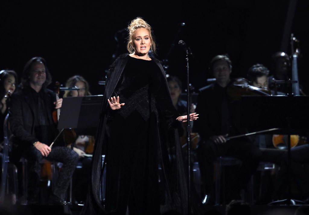 . Adele performs a tribute to George Michael at the 59th annual Grammy Awards on Sunday, Feb. 12, 2017, in Los Angeles. (Photo by Matt Sayles/Invision/AP)