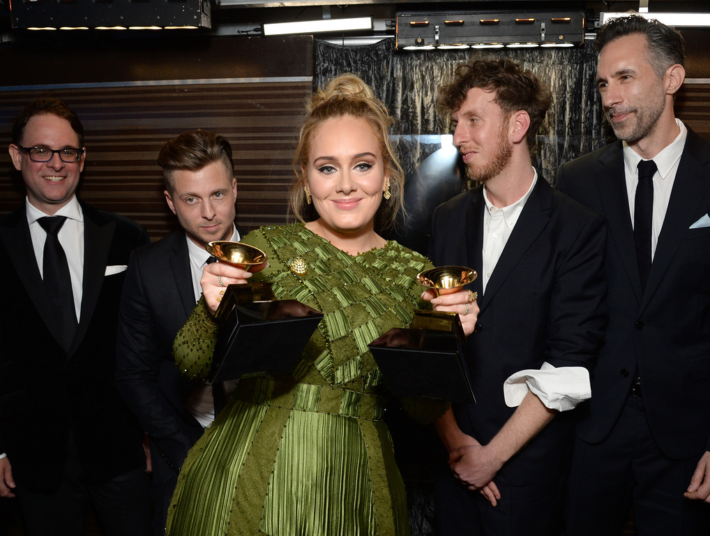 . LOS ANGELES, CA - FEBRUARY 12:  Recording artist-producer Ryan Tedder (second from left), recording artist Adele (C), producer Ariel Rechtshaid (second from right), and producer Samuel Dixon (R), co-recipients of the Album Of The Year award for \'25,\' pose backstage during the The 59th GRAMMY Awards at STAPLES Center on February 12, 2017 in Los Angeles, California.  (Photo by Michael Kovac/Getty Images for NARAS)
