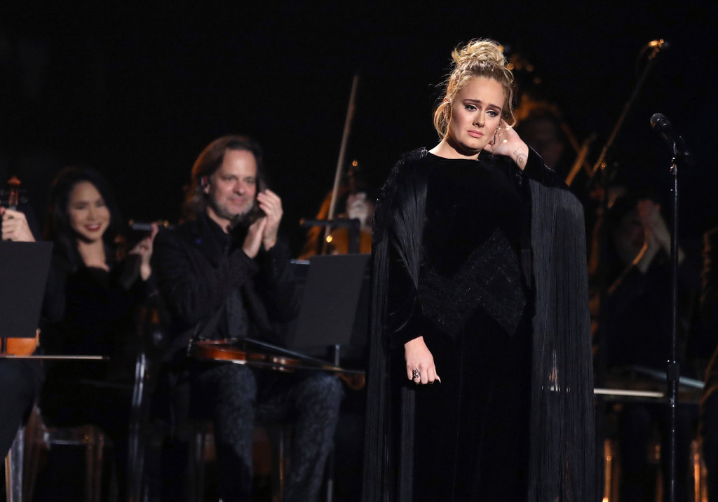 . Adele reacts after a performance tribute to George Michael at the 59th annual Grammy Awards on Sunday, Feb. 12, 2017, in Los Angeles. (Photo by Matt Sayles/Invision/AP)