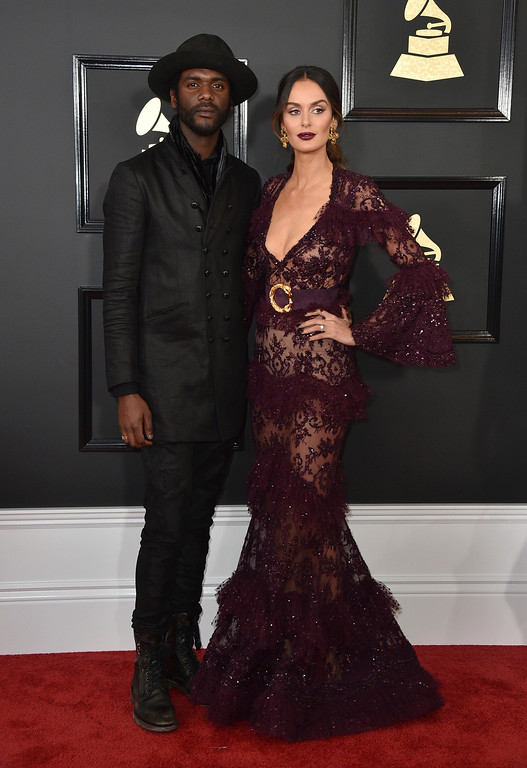 . Gary Clark Jr., left, and Nicole Trunfio arrive at the 59th annual Grammy Awards at the Staples Center on Sunday, Feb. 12, 2017, in Los Angeles. (Photo by Jordan Strauss/Invision/AP)