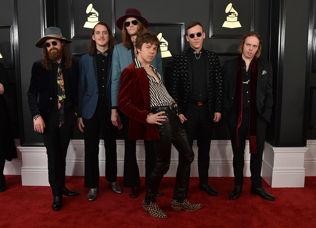 . Matthan Minster, from left, Nick Bockrath, Daniel Tichenor, Matthew Shultz, Brad Shultz, and Jared Champion of the musical group Cage the Elephant arrive at the 59th annual Grammy Awards at the Staples Center on Sunday, Feb. 12, 2017, in Los Angeles. (Photo by Jordan Strauss/Invision/AP)