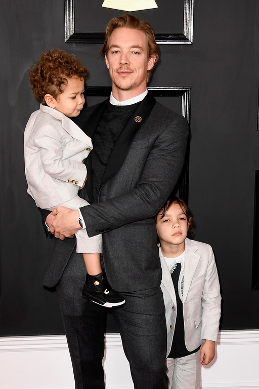 . LOS ANGELES, CA - FEBRUARY 12:  Producer Diplo (C) and sons attend The 59th GRAMMY Awards at STAPLES Center on February 12, 2017 in Los Angeles, California.  (Photo by Frazer Harrison/Getty Images)