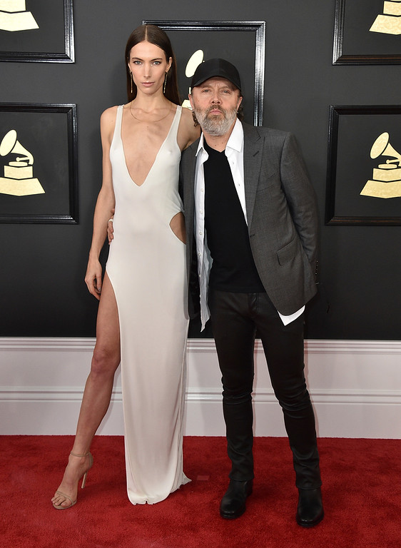. Jessica Miller, left, and Lars Ulrich arrive at the 59th annual Grammy Awards at the Staples Center on Sunday, Feb. 12, 2017, in Los Angeles. (Photo by Jordan Strauss/Invision/AP)