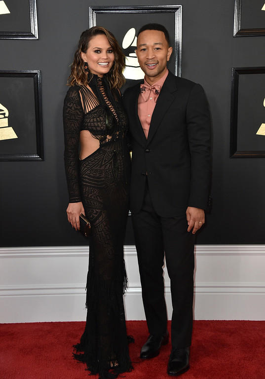 . Chrissy Teigen, left, and John Legend, arrive at the 59th annual Grammy Awards at the Staples Center on Sunday, Feb. 12, 2017, in Los Angeles. (Photo by Jordan Strauss/Invision/AP)
