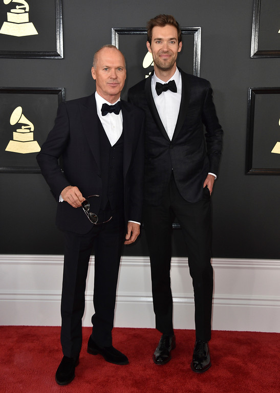 . Michael Keaton, from left, and Sean Douglas arrive at the 59th annual Grammy Awards at the Staples Center on Sunday, Feb. 12, 2017, in Los Angeles. (Photo by Jordan Strauss/Invision/AP)