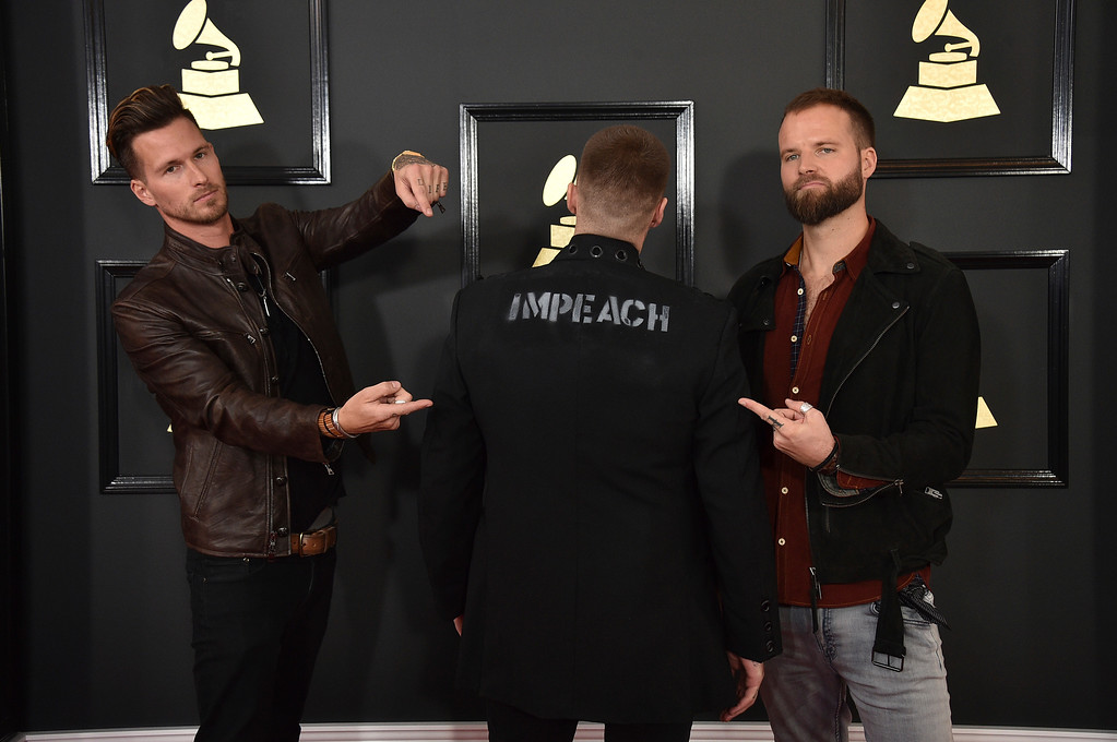 . Ryan Meyer, from left, Johnny Stevens, and Rich Meyer of the musical group Highly Suspect arrive at the 59th annual Grammy Awards at the Staples Center on Sunday, Feb. 12, 2017, in Los Angeles. (Photo by Jordan Strauss/Invision/AP)