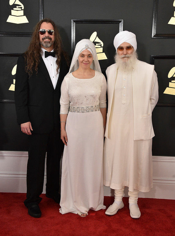 . Adam Berry, from left, Gurujas, and Hari Jiwan Singh Khalsa of the musical group White Sun arrive at the 59th annual Grammy Awards at the Staples Center on Sunday, Feb. 12, 2017, in Los Angeles. (Photo by Jordan Strauss/Invision/AP)