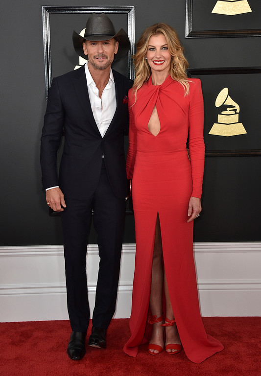 . Tim McGraw, left, and Faith Hill arrive at the 59th annual Grammy Awards at the Staples Center on Sunday, Feb. 12, 2017, in Los Angeles. (Photo by Jordan Strauss/Invision/AP)
