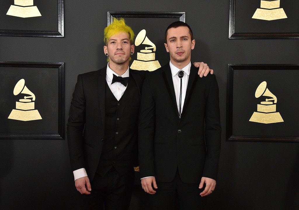 . Josh Dun, left, andTyler Joseph of the musical group Twenty One Pilots arrive at the 59th annual Grammy Awards at the Staples Center on Sunday, Feb. 12, 2017, in Los Angeles. (Photo by Jordan Strauss/Invision/AP)