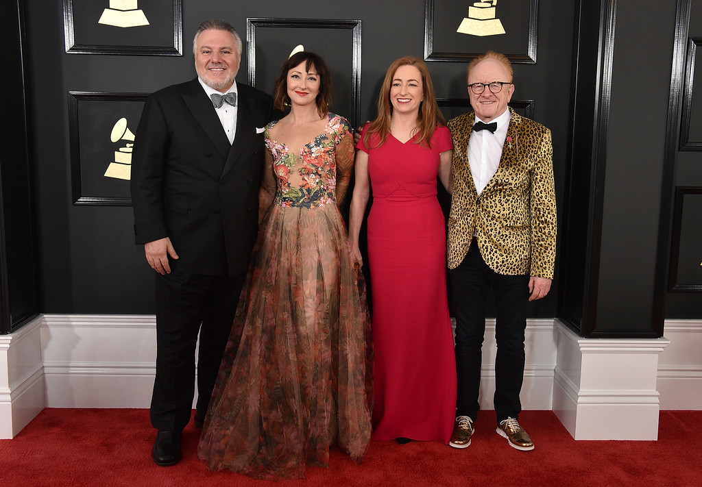 . Jay Alix, from left, Carmen Cusack, Una Jackman, and Peter Asher arrive at the 59th annual Grammy Awards at the Staples Center on Sunday, Feb. 12, 2017, in Los Angeles. (Photo by Jordan Strauss/Invision/AP)