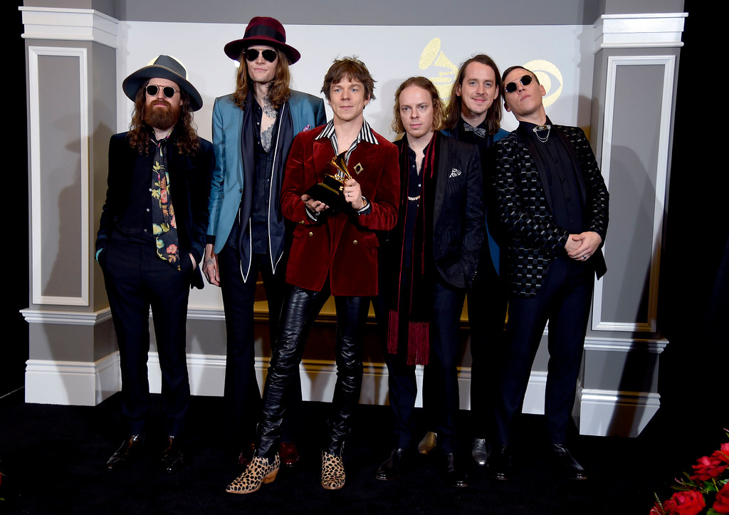 """. Matthan Minster, from left, Daniel Tichenor, Matthew Shultz, Jared Champion, Nick Bockrath, and Brad Shult, of the musical group Cage the Elephant , pose in the press room with the award for best rock album for \""""Tell Me I\'m Pretty\"""" at the 59th annual Grammy Awards at the Staples Center on Sunday, Feb. 12, 2017, in Los Angeles. (Photo by Chris Pizzello/Invision/AP)"""