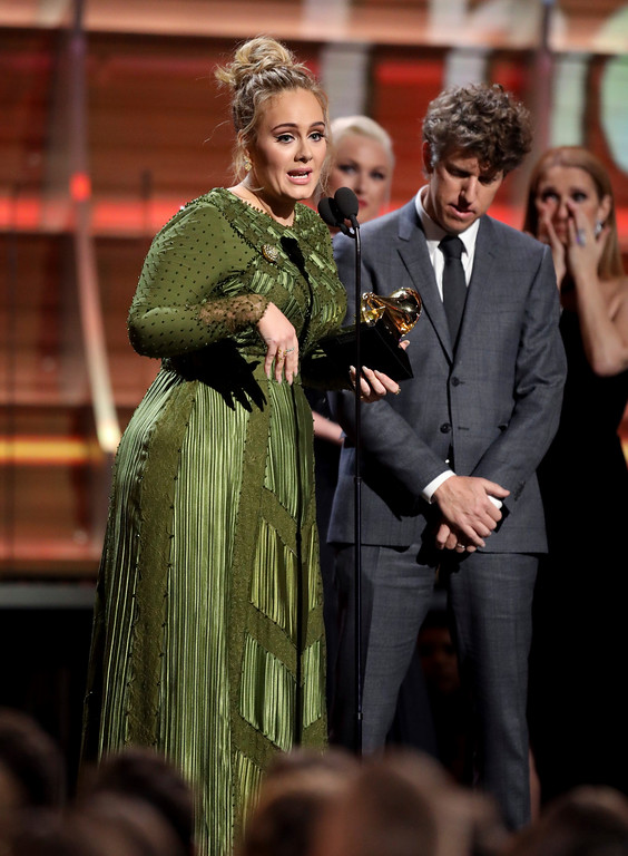 ". Adele accepts the award for song of the year for ""Hello\"" at the 59th annual Grammy Awards on Sunday, Feb. 12, 2017, in Los Angeles. (Photo by Matt Sayles/Invision/AP)"