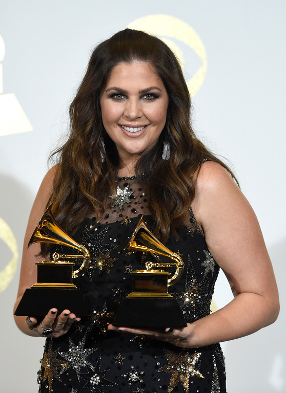 ". Hillary Scott poses in the press room with with the awards for best contemporary christian music album for ""Love Remains\"" and best contemporary christian music song for \""Thy Will\"" at the 59th annual Grammy Awards at the Staples Center on Sunday, Feb. 12, 2017, in Los Angeles. (Photo by Chris Pizzello/Invision/AP)"