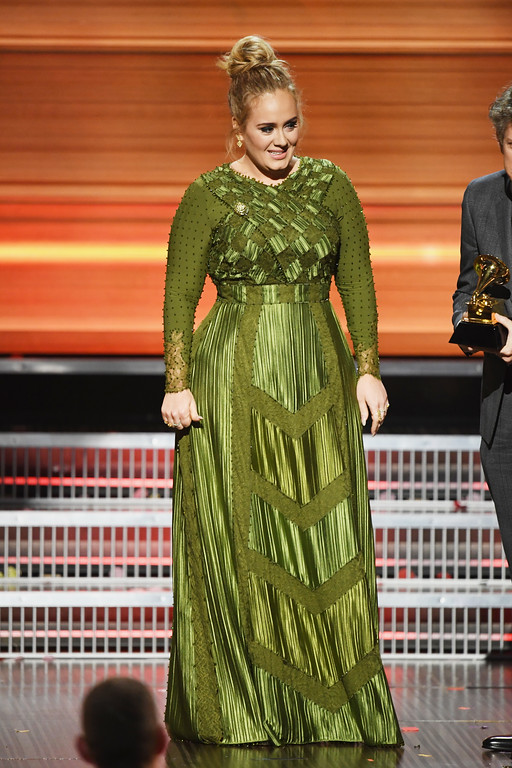. LOS ANGELES, CA - FEBRUARY 12:  Songwriter Adele Adkins accepts the Song Of The Year award for \'Hello\' onstage during The 59th GRAMMY Awards at STAPLES Center on February 12, 2017 in Los Angeles, California.  (Photo by Kevin Winter/Getty Images for NARAS)