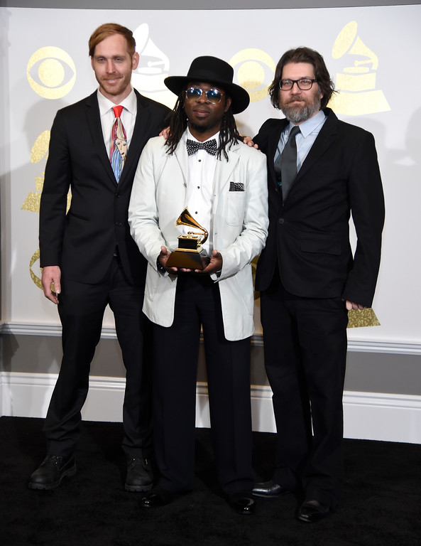 """. Snarky Puppy pose in the press room with with the award for best contemporary instrumental album for \""""Culcha Vulcha\"""" at the 59th annual Grammy Awards at the Staples Center on Sunday, Feb. 12, 2017, in Los Angeles. (Photo by Chris Pizzello/Invision/AP)"""