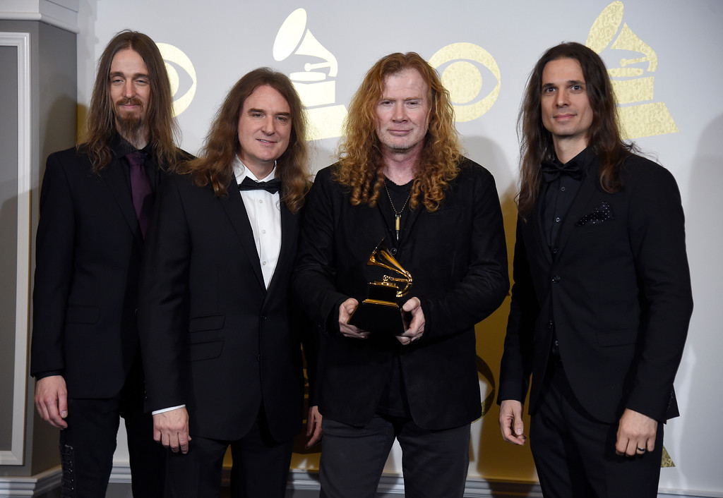 """. Dirk Verbeuren, from left, David Ellefson, Dave Mustaine and Kiko Loureiro pose in the press room with the award for best metal performance for \""""Dystopia\"""" at the 59th annual Grammy Awards at the Staples Center on Sunday, Feb. 12, 2017, in Los Angeles. (Photo by Chris Pizzello/Invision/AP)"""