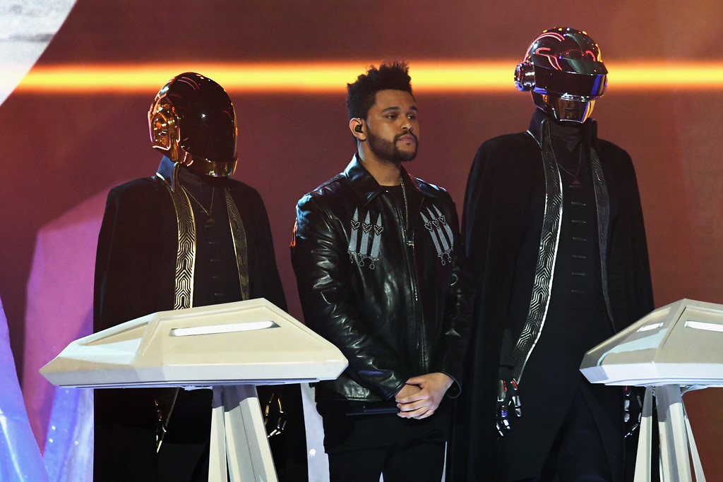 . LOS ANGELES, CA - FEBRUARY 12:  Recording artist The Weeknd (C) and music group Daft Punk perform onstage during The 59th GRAMMY Awards at STAPLES Center on February 12, 2017 in Los Angeles, California.  (Photo by Kevin Winter/Getty Images for NARAS)