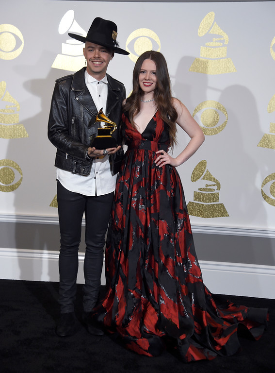 """. Jesse Huerta, left, and Joy Huerta, of Jesse & Joy, pose in the press room with the award for best latin pop album for \""""Un Besito Mas\"""" at the 59th annual Grammy Awards at the Staples Center on Sunday, Feb. 12, 2017, in Los Angeles. (Photo by Chris Pizzello/Invision/AP)"""