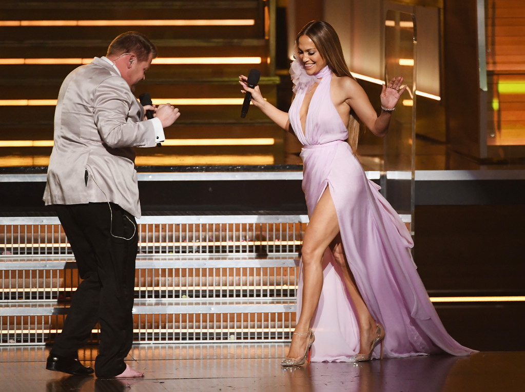 . LOS ANGELES, CA - FEBRUARY 12:  Host James Corden (L) greets recording artist-actor Jennifer Lopez onstage during The 59th GRAMMY Awards at STAPLES Center on February 12, 2017 in Los Angeles, California.  (Photo by Kevin Winter/Getty Images for NARAS)