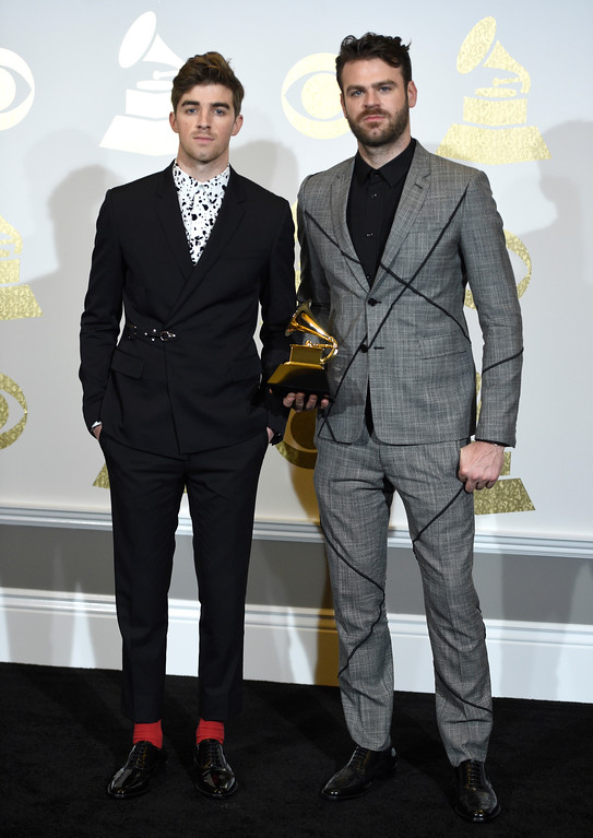 """. Andrew Taggart, left, and Alex Pall of The Chainsmokers pose in the press room with the award for best dance recording for \""""Don\'t Let Me Down\"""" at the 59th annual Grammy Awards at the Staples Center on Sunday, Feb. 12, 2017, in Los Angeles. (Photo by Chris Pizzello/Invision/AP)"""