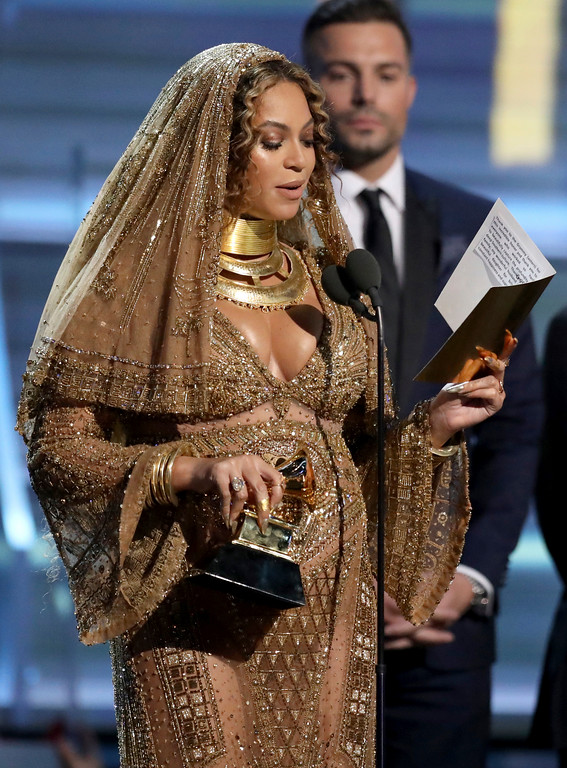 """. Beyonce accepts the award for best urban contemporary album for \""""Lemonade\"""" at the 59th annual Grammy Awards on Sunday, Feb. 12, 2017, in Los Angeles. (Photo by Matt Sayles/Invision/AP)"""