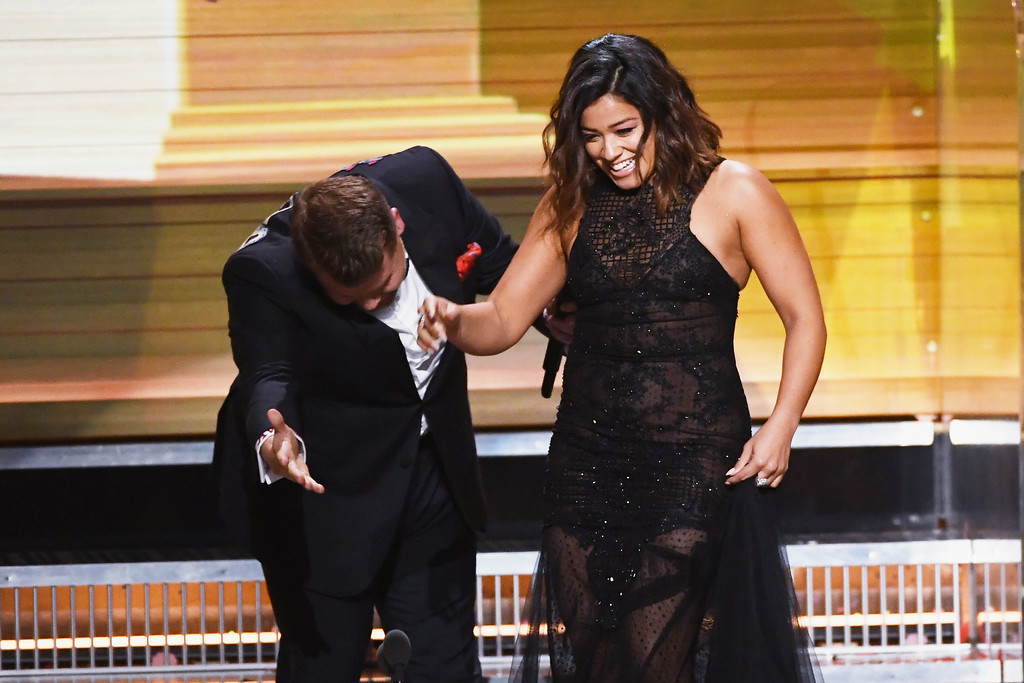 . LOS ANGELES, CA - FEBRUARY 12:  Host James Corden (L) and actor Gina Rodriguez speak onstage during The 59th GRAMMY Awards at STAPLES Center on February 12, 2017 in Los Angeles, California.  (Photo by Kevin Winter/Getty Images for NARAS)