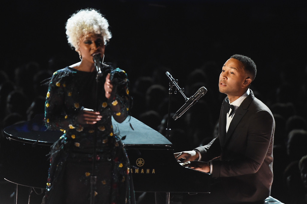 . LOS ANGELES, CA - FEBRUARY 12:  Recording artists Cynthia Erivo (L) and John Legend perform onstage during The 59th GRAMMY Awards at STAPLES Center on February 12, 2017 in Los Angeles, California.  (Photo by Kevin Winter/Getty Images for NARAS)