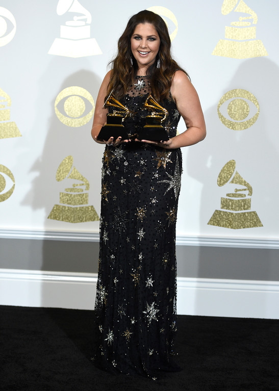 """. Hillary Scott poses in the press room with with the awards for best contemporary christian music album for \""""Love Remains\"""" and best contemporary christian music song for \""""Thy Will\"""" at the 59th annual Grammy Awards at the Staples Center on Sunday, Feb. 12, 2017, in Los Angeles. (Photo by Chris Pizzello/Invision/AP)"""